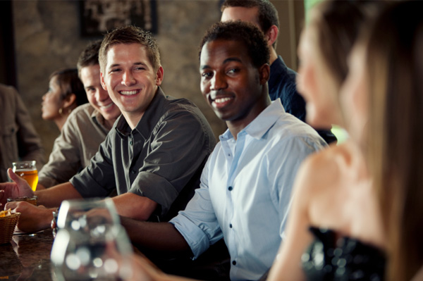woman-flirting-with-group-of-men-at-bar