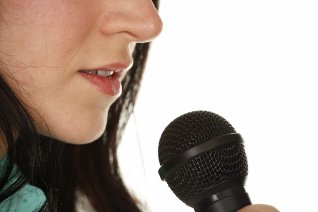 Woman's Mouth to Microphone Close-up