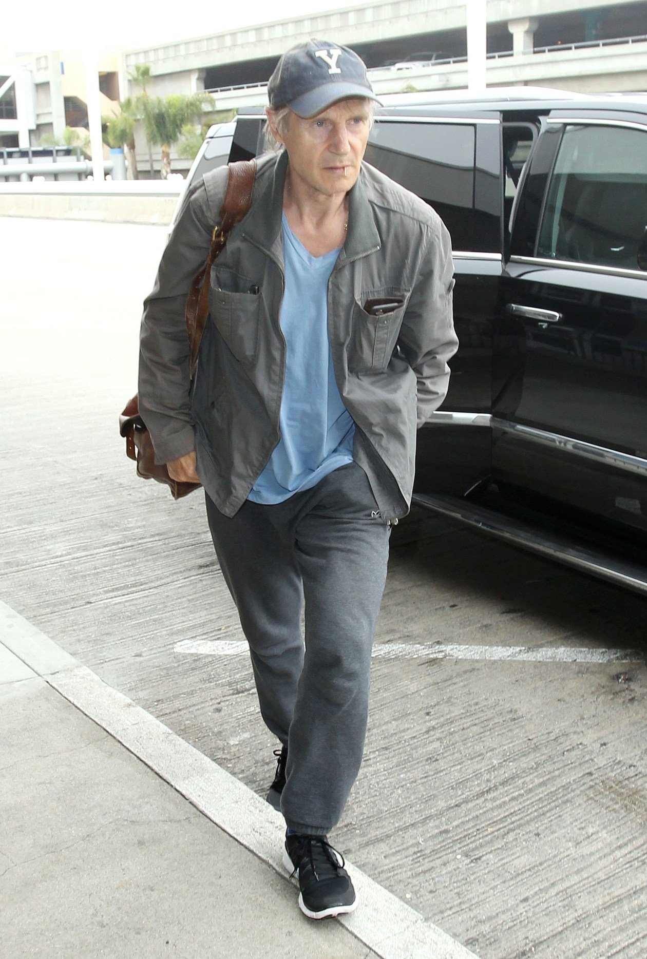 Liam Neeson arriving at the Los Angeles International Airport