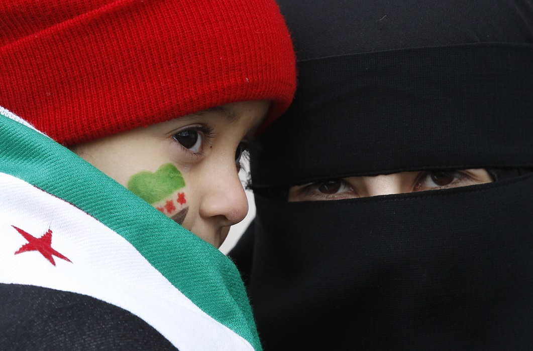 A Syrian girl attends a protest against President Bashar Al-Assad with her mother in Istanbul