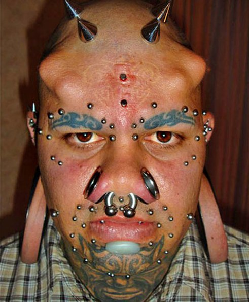 extreme-tattoo-and-piercing-on-face