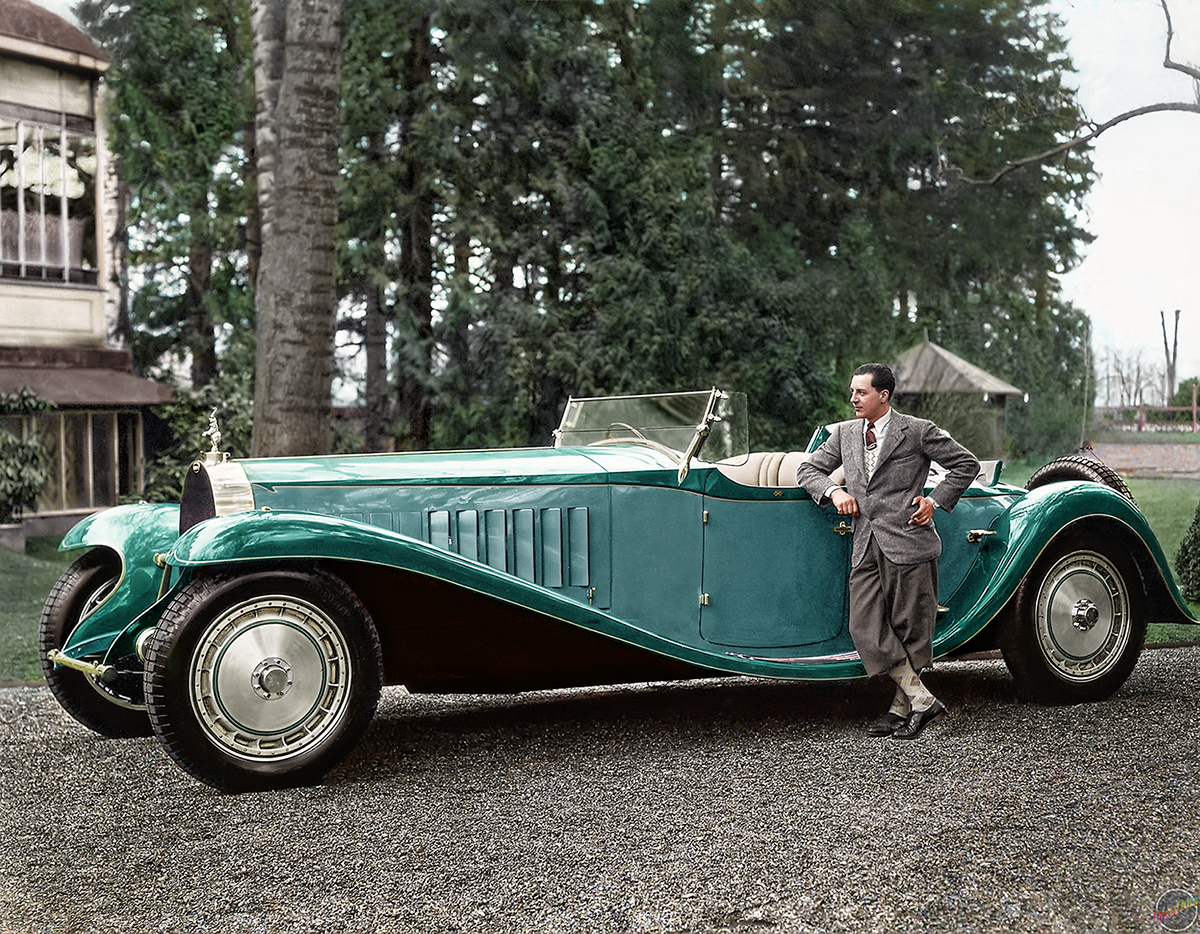 Colorized black and white photo of Jean bugatti next to the Roya