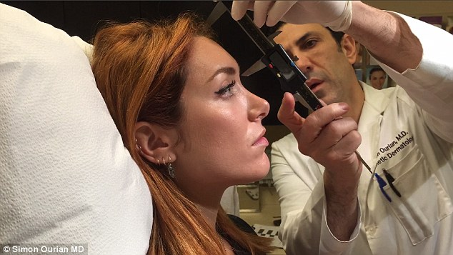 2EC56BFD00000578-3332184-Joanna_pictured_as_Dr_Ourian_measures_her_nose_as_part_of_the_pr-a-5_1448957184001