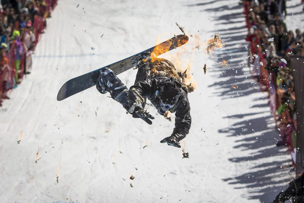 A snowboarder performs during the Red Bull Jump and Freeze competition at ski resort Shimbulak