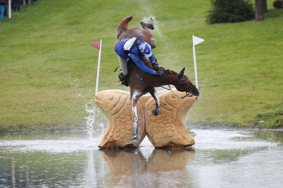 Russia's Mikhail Nastenko riding Reistag falls at the Lochan fence in the cross country event of FEI European Eventing Championship at Blair Castle ,Scotland