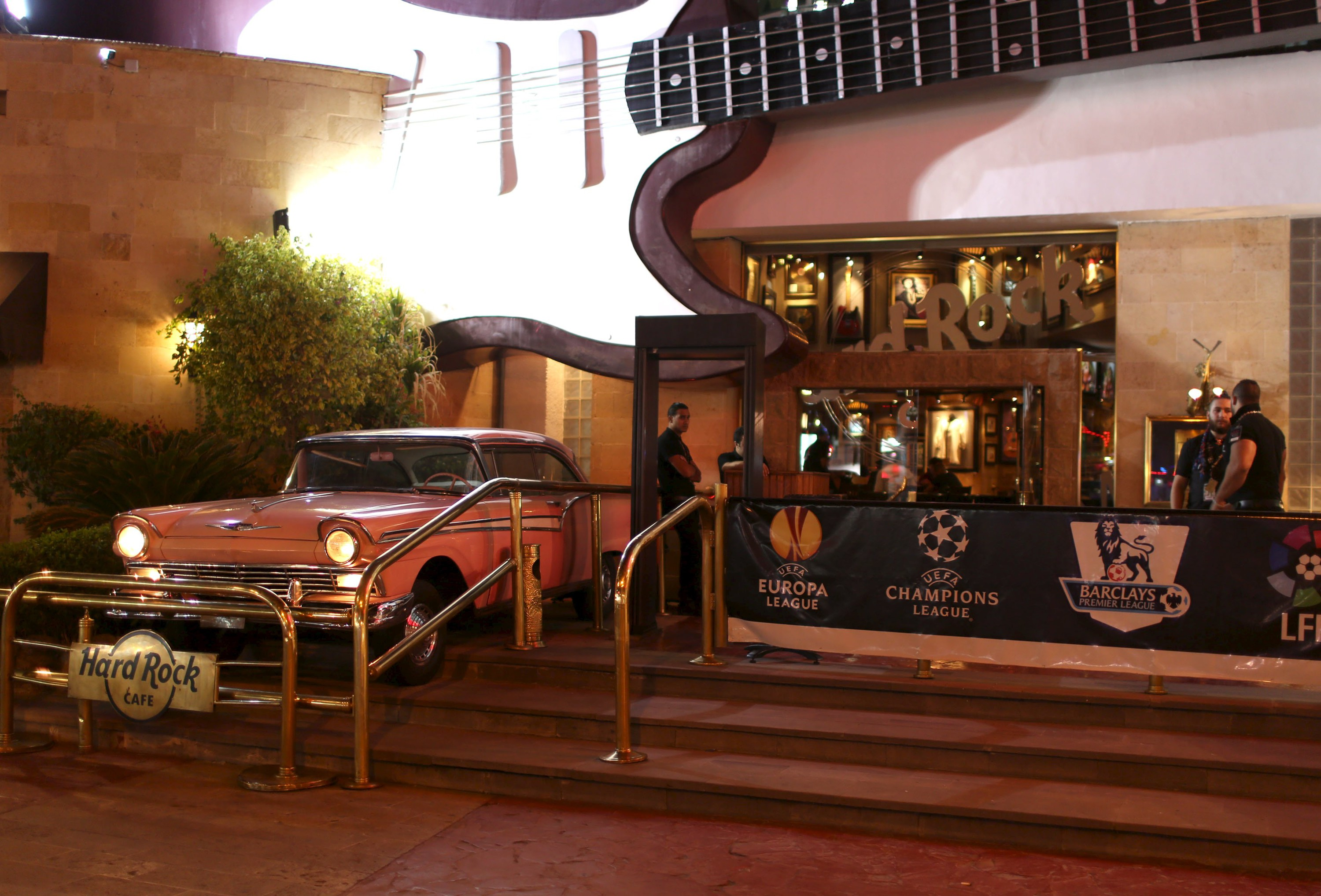 Employees wait at the entrance of Hard Rock Cafe in the Red Sea resort of Sharm el-Sheikh