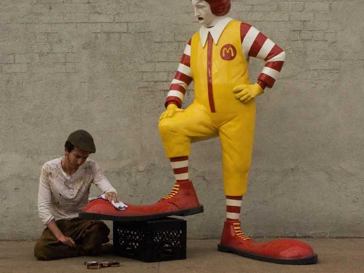 ronald-mcdonald-gets-his-shoes-shined-in-todays-banksy-work
