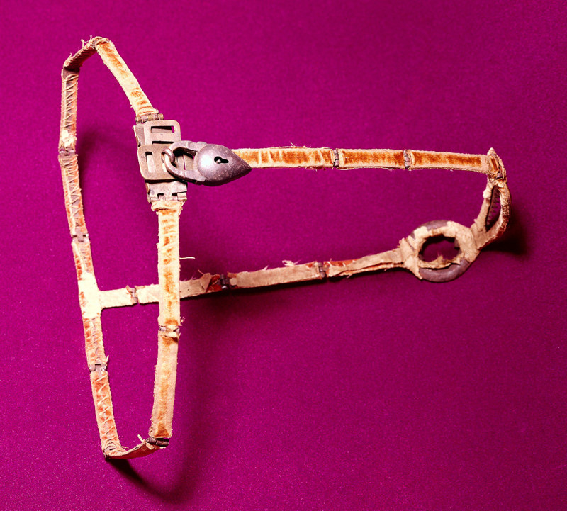M0012512 Chastity belt, iron covered with velvet and silk.