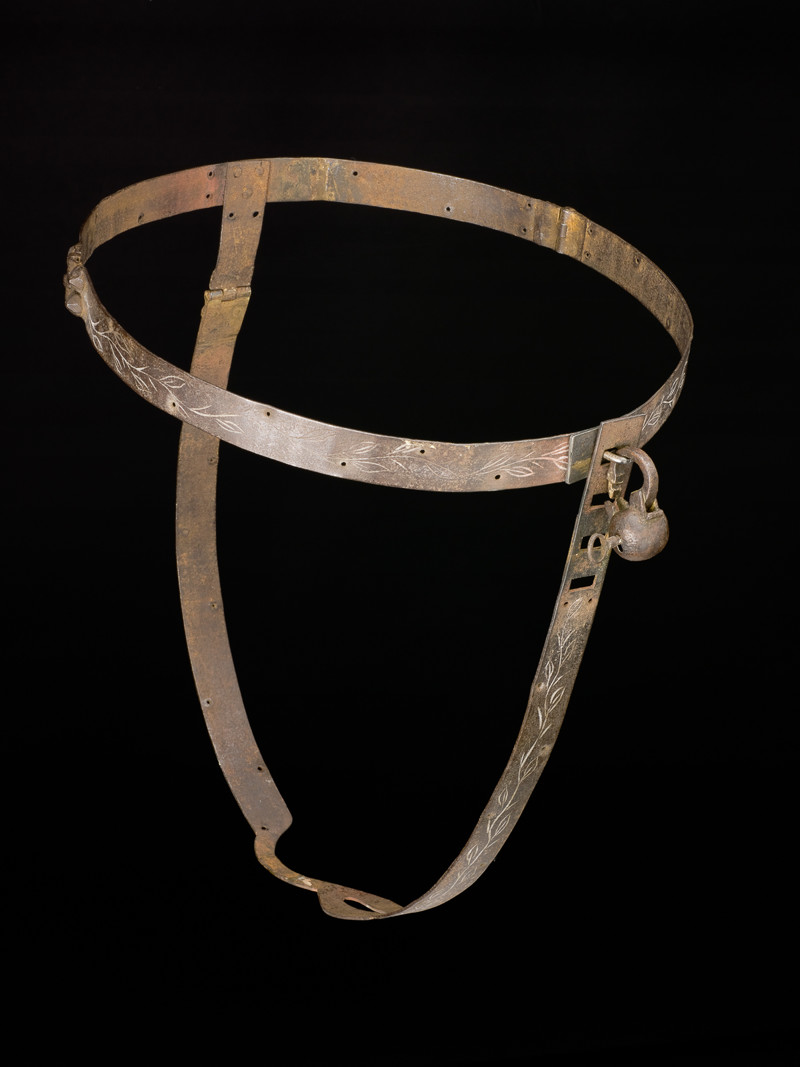 Iron chastity belt complete with padlock.