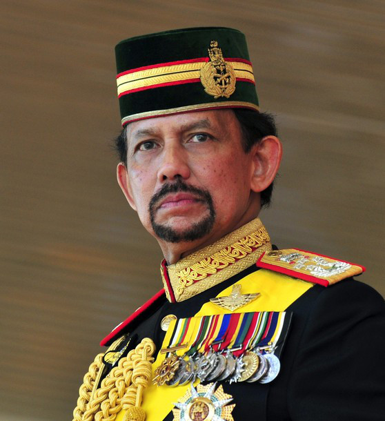 Brunei's Sultan Hassanal Bolkiah stands during his 64th birthday celebrations in Bandar Seri Begawan