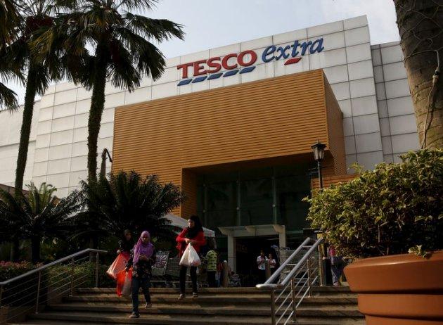 Women leave a Tesco Extra store in Kuala Lumpur, Malaysia