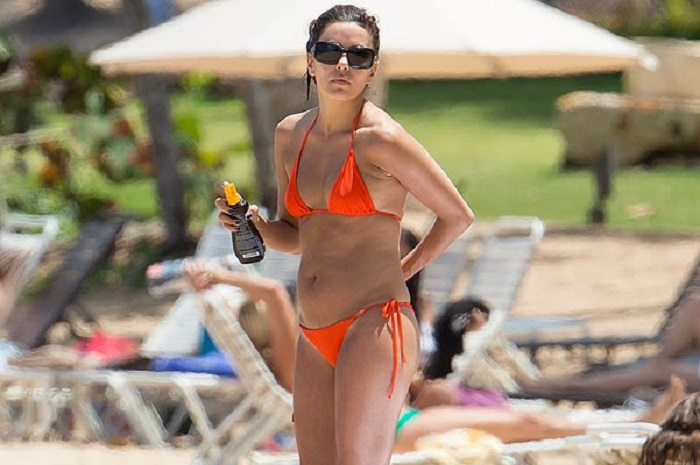 EXCLUSIVE: *** WARNING SOME NUDITY *** Eva Longora has an embarrassing costume malfunction as she soaks up the sun in Puerto Rico
