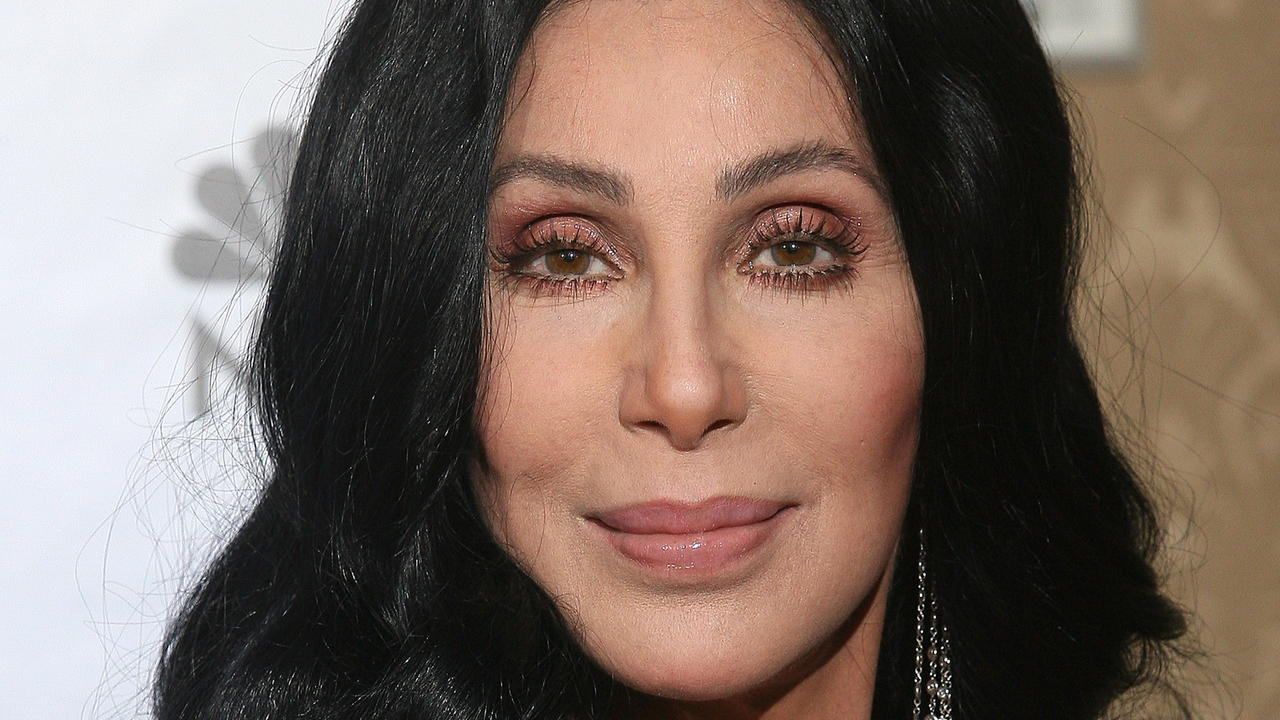 Cher poses in the photo room at the 67th