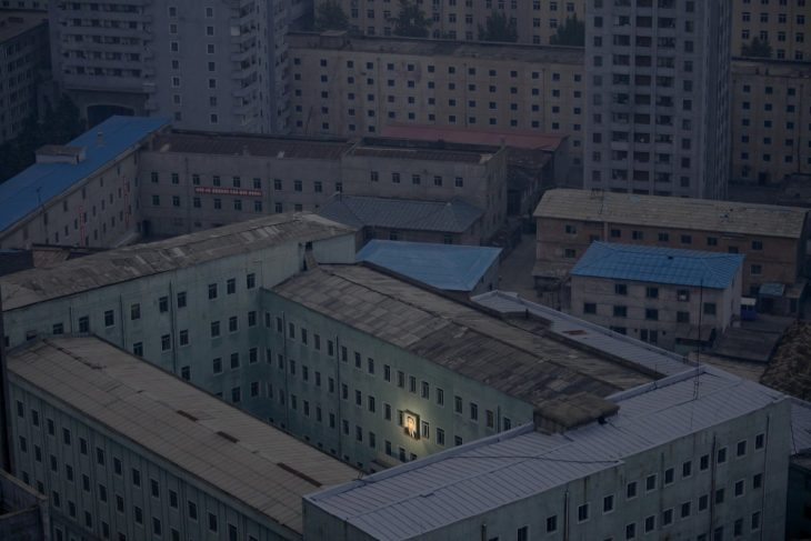 north-korea-doesnt-have-enough-of-its-own-electricity-so-at-night-the-entire-country-goes-pitch-black-what-little-remains-goes-toward-illuminating-a-picture-of-the-countrys-founder-kim-il-sung-730x487