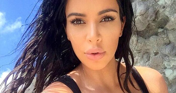 1440603619_kim-kardashian-pregnancy-lips-zoom