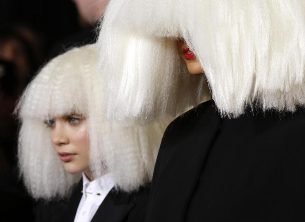 Singer Sia and dancer Maddie Ziegler arrive at the 57th annual Grammy Awards in Los Angeles