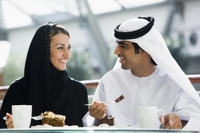A Middle Eastern couple enjoying a meal in a restaurant