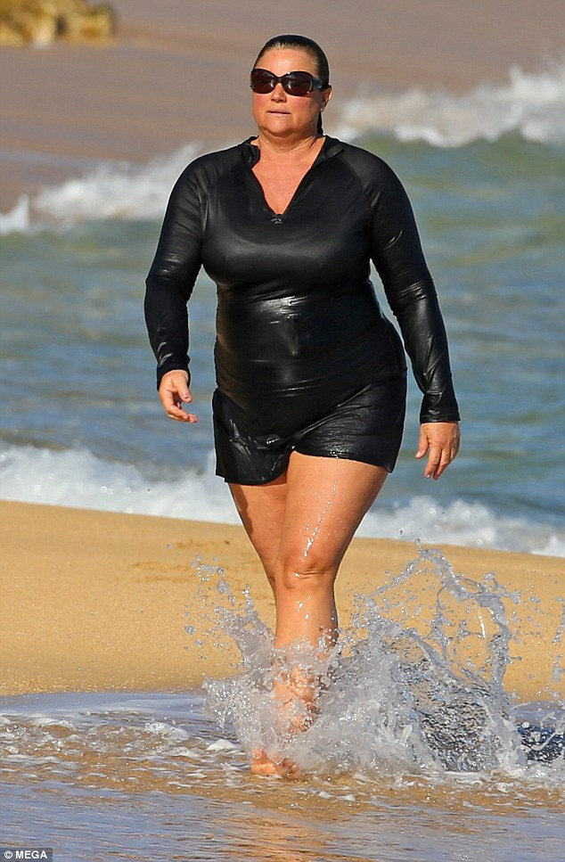 3c1538a900000578-4114608-loved_the_water_keely_52_hit_the_surf_in_a_black_bathing_suit-m-78_1484251336602