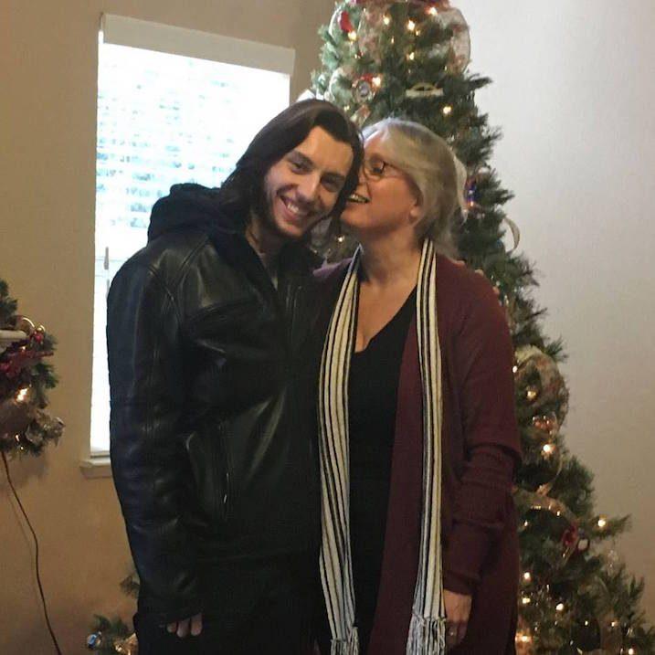 couple-smiling-christmas-tree