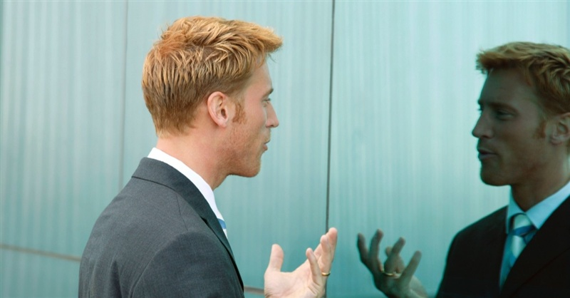 13140-man-talking-reflection.800w.tn